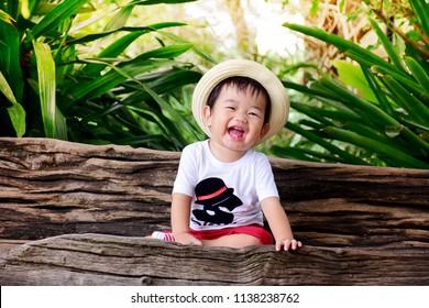 Asian little cute boy are smaAsian little cute boy are good laugh