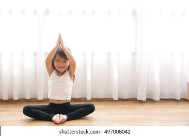 asian little cute girl do a yoga at home with space for add text
