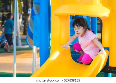 Asian little cute girl in the playground