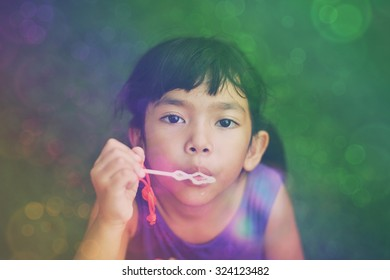 Asian little  girl  with  bubble  in vintage  color  tone