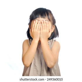asian little girl cover her face with her hand isolated in white background