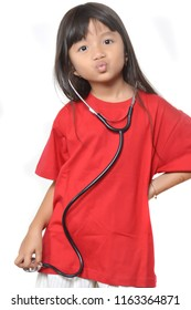 asian little girl dressed in red with a stethoscope
