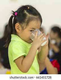 Asian little girl is drinking milk. She is 3.5 years old