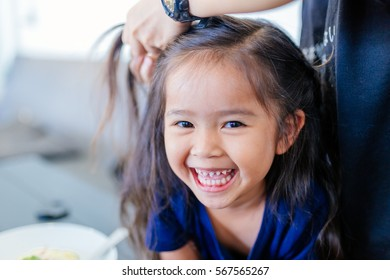 asian little girl happy smiling make up and salon hair.