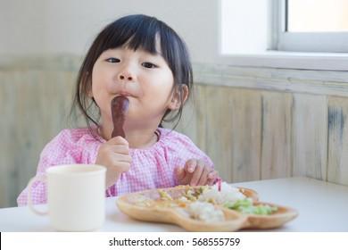 asian little girl having lunch