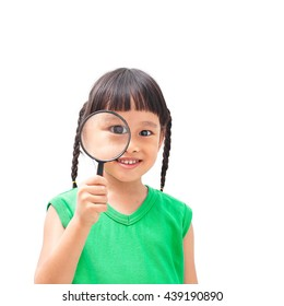 asian little girl looking through a magnifying glass