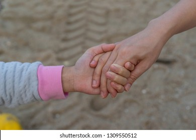 Asian little girl Mother Holding hands Walking