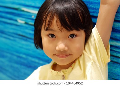 Asian little girl on blue background