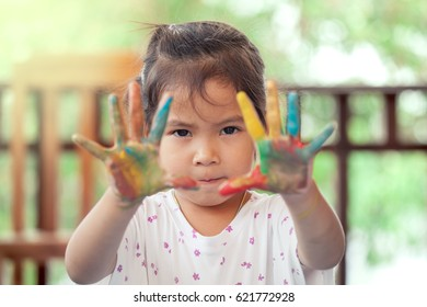 asian little girl with painted hands