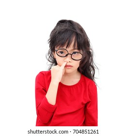 Asian little girl picking a nose with bugging face isolated on white background