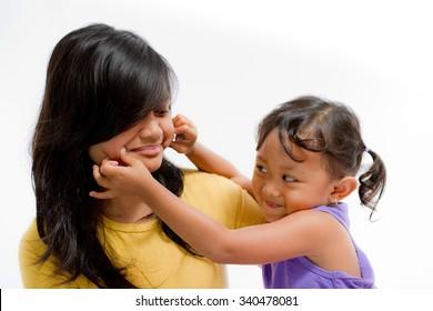 Asian Little Girl Pinch Teen Sister Cheek