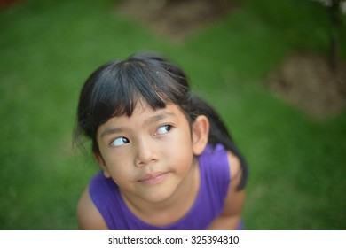 Asian little girl playing water bubble