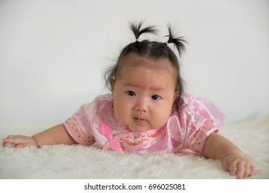 Asian little girl in traditional Chinese dress