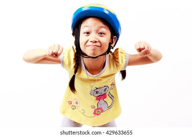 Asian little girl Wearing a bike helmet,Ready to Exercise, Isolated on white : soft focus