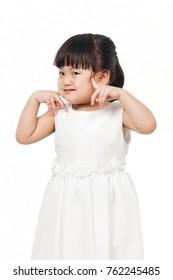 Asian Little girl in white dress.