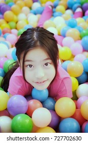 Asian long hair girl playing colorful ball