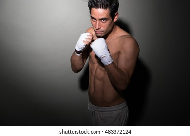 Asian look street MMA fighter ready for a fight - Muscular Ripped Asian men doing martial arts - fitness concept
