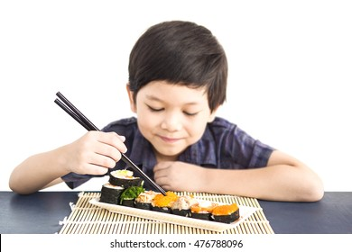 Asian lovely boy is eating sushi over white background