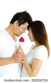 Asian loving couple holding rose
