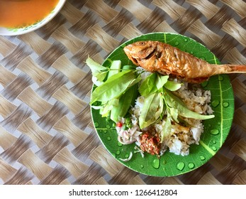 Asian Lunch Dish white rice, fried fish with veggies and fish sauce