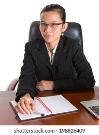 Asian Malay woman at her office desk over white background