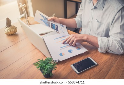 Asian Male accountant or banker making calculations. Savings, finance and economy concept.