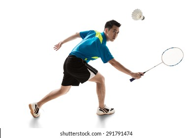 Asian male badminton player on white background. backhand.