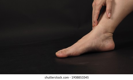Asian Male barefoot is isolated on black background.