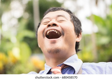 Asian male business man showing happy gesture