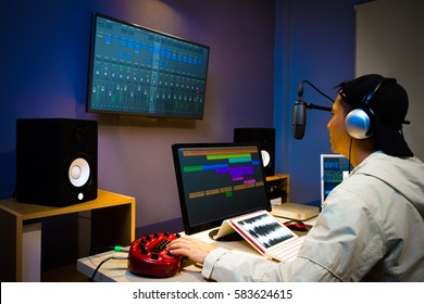 asian male DJ working in digital broadcasting studio, online radio station, podcast, post production technology