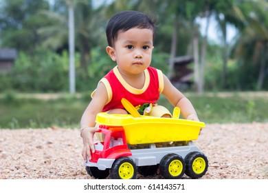 Asian male kid face closeup ,kid playing