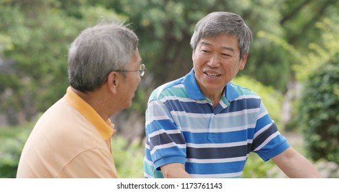 Asian Male old friends talking together at outdoor park