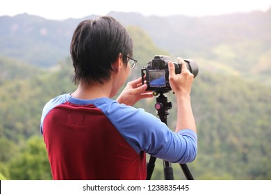 Asian male photographer from Thailand