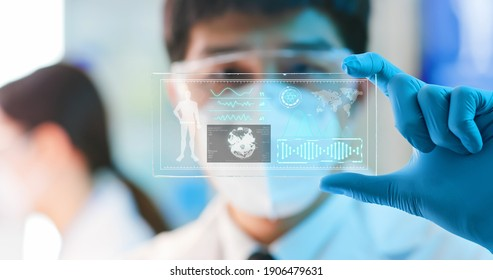 asian male scientist analyzing structure of  DNA on a tablet in a modern laboratory environment - using display technology to examine neurons