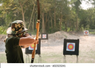 Asian Male Soldier training with the arror and bow