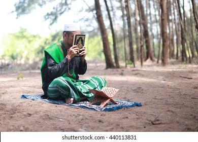 Asian Man Arabic Clothes Reading Quran Stock Photo (Edit Now