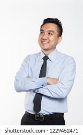 Asian man with arms crossed smiling