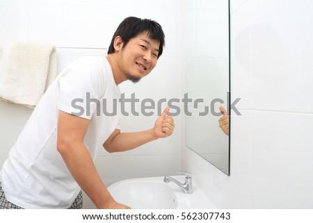 Asian guy in bathroom