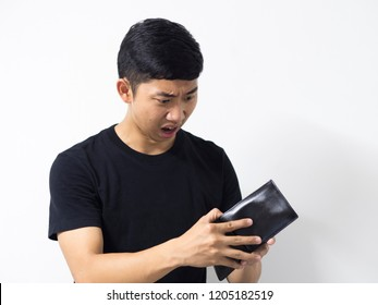 Asian man black shirt shocked about money in his wallet and feel sad in white isolated background