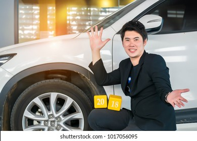 Asian man with box number 2018 for happy new year image.To the transport, automotive and everyone on a office background.  Using life insurance or Health, business welcome new year photo