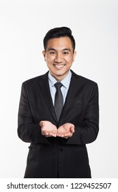 Asian man in business suit put his hand together, holding concept