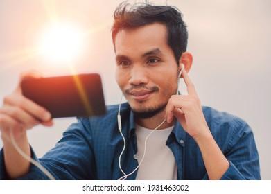 Asian man call phone happy online communication