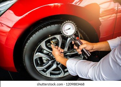 Asian man car inspection Measure quantity Inflated Rubber tirescar.Close up hand holding machine Inflated pressure gauge for car tyrepressure measurement for automotive, automobile image