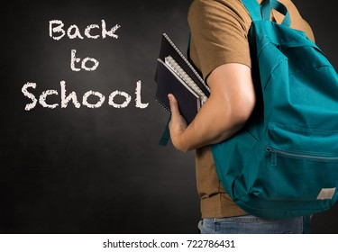asian man carry bag and holding study book with Back to school concept