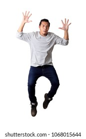 The Asian man in casual clothes on the white background.