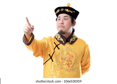 The Asian man in Chinese emperor clothes.