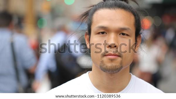 Asian man in city face portrait