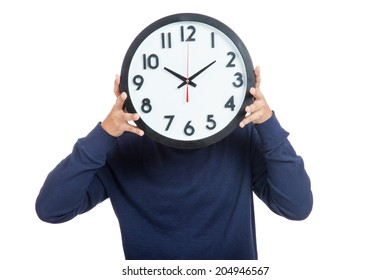 Asian man close his face with  a clock isolated on white background