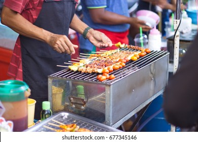 Asian man are cooking barbecue, Pranburi night market  Thailand.