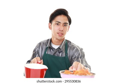 Asian man cooking healthy food